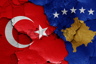 flags of Turkey and Kosovo painted on cracked wall