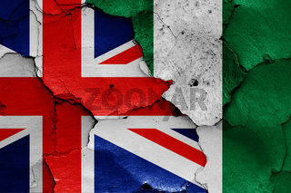 flags of UK and Nigeria painted on cracked wall