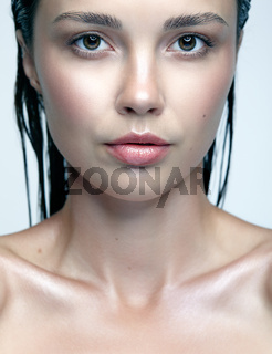 Beauty portrait of female  with shiny glitter skin. Woman with natural beauty makeup