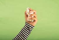 Woman clenched in fist marshmallow