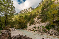 Beautiful autumn view of the Tschaminbach mountain stream in Weisslahnbad near Tiers, Italy