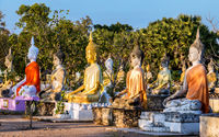 A colorful group of Buddha statues at the Buddhist Cemetery