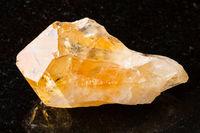 crystal of Citrine gemstone on black