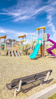 Vertical frame Small kids playground with colorful slides during day