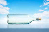 lying glass bottle landscape scenery background