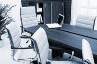 laptop on a desk in modern office
