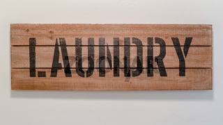 Panorama frame Painted wooden Laundry sign on white wall