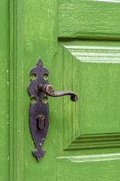 Old green wooden door and door handle
