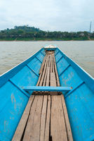 Crossing Mekong river by boat