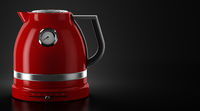 red electric kettle on black background with copyspace