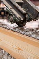 At sawmill. Image of cut wood using machine