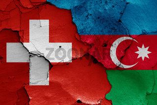 flags of Switzerland and Azerbaijan painted on cracked wall