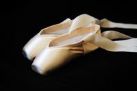 Ballet pointes isolated on a black background