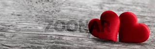 Red fabric hearts on wood