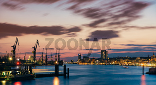 The skyline of the harbor promenade and the docks build a great panorama during the blue hour at sundown