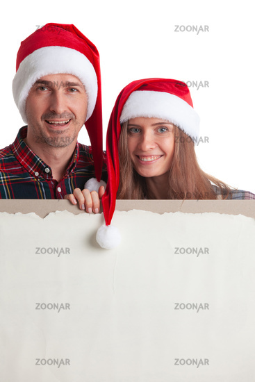 Couple in Santa hats with banner