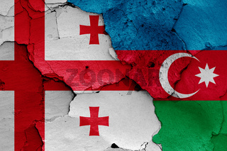 flags of Georgia and Azerbaijan painted on cracked wall