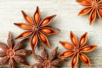 star anise fruits on the wooden board, top view