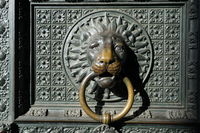 Impressive door knocker in the form of a lion's head at a gate of Cologne Cathedral