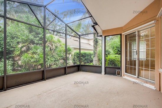 Empty Screened in Porch Attached to Modern House Outdoor No Furniture Home Netting