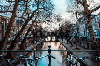 Bikes on a Bridge in Amsterdam, Netherlands Wet Overcast Weather Vacation Destination Transportation