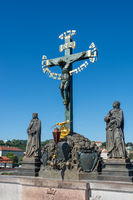 Crucifix statue on the Charles Bridge in Prague