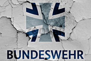 flag of Bundeswehr painted on cracked wall