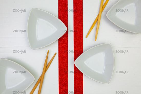 Ceramic bowls  and bamboo chopsticks for sushi food