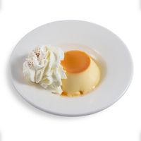 Dessert of flan with cream.