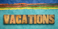 vacations concept in wood type and handmade paper