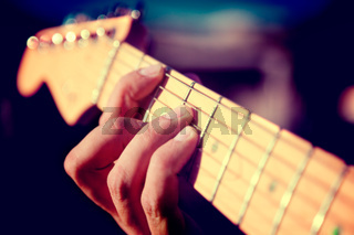 Guitar detail. Playing instrument.Hand and chord