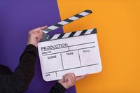 movie clapper on purple background