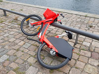 Reckless filed ebike from Jump on a street in Berlin as an accident source, editorial use only