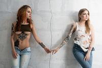 Sexy tattooed girls parting cropped view