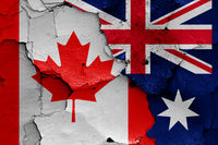 flags of Canada and Australia painted on cracked wall