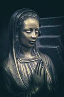 praying bronze maria tomb statue