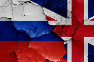 flags of Russia and UK painted on cracked wall