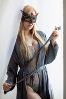 Young adorable blonde in a mask