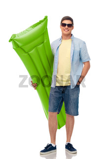 man in sunglasses with inflatable pool mattress