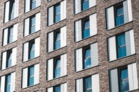 windows on hotel building facade or office building exterior -