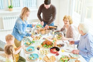 Happy Family at Dinner in Sunlight