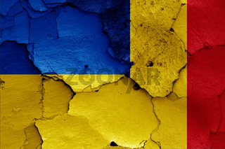 flags of Ukraine and Romania painted on cracked wall