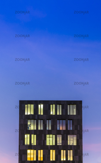 modern office building at dusk against blue evening sky