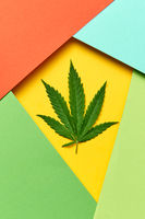 Geometric frame from colored paper with cannabis leaf.
