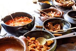 Wood burning stove with traditional brazilian food