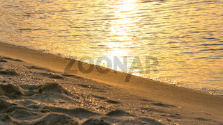 Sand and waves at sunrise in Sunny Beach on the Black Sea coast of Bulgaria