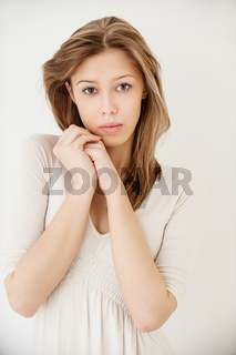 young beautiful woman in white dress close up