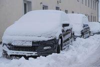 snowed car - winter break and snow track