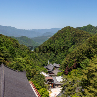 Panoramic view to Korean Buddhist Temple Complex Guinsa with valley and mountains on a clear sunny day. Guinsa, Danyang Region, South Korea, Asia.