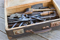 A suitcase with old hand metal tools